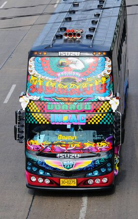 BANGKOK - SEPTEMBER 3: Double-decker bus with vivid paintings on his front side on the street of Bangkok. Bangkok, Thailand - September 3, 2011. Stock Photo - 16585524