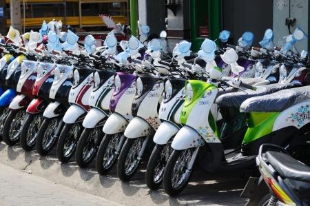 BANGKOK - SEPTEMBER 3: New scooters for sale in the shop on the street of Bangkok. Bangkok, Thailand - September 3, 2011. Stock Photo - 16585519