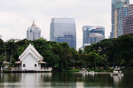 settles: BANGKOK - SEPTEMBER 5: Big lake in the Lumpini Park. Lumpini Park settles down in downtown of Bangkok. Bangkok, Thailand - September 5, 2011.