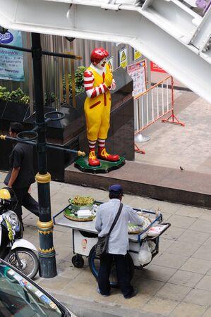 BANGKOK - SEPTEMBER 6: Seller of thai food on the street opposite the McDonald Stock Photo - 16585509