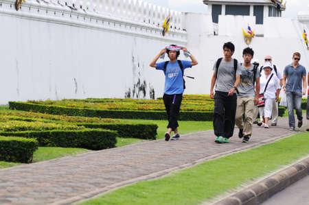 BANGKOK - SEPTEMBER 7: Japanese and european tourists walk on the pedestrian walkway near Grand Palace in Bangkok. Bangkok, Thailand - September 7, 2011. Stock Photo - 16585502