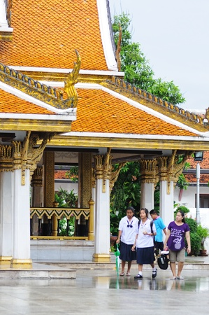 BANGKOK - SEPTEMBER 7:  Thai people walk in the temple's territory after a rain. Bangkok, Thailand - September 7, 2011. Stock Photo - 16585339