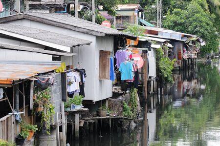 outskirts: BANGKOK - SEPTEMBER 8: Small houses on the river on the outskirts of Bangkok. Bangkok, Thailand - September 8, 2011.