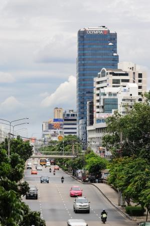 BANGKOK - SEPTEMBER 8: Cars, taxis, buses and motorcycles ride on the road in the downtown of Bangkok. Bangkok, Thailand - September 8, 2011. Stock Photo - 16585511