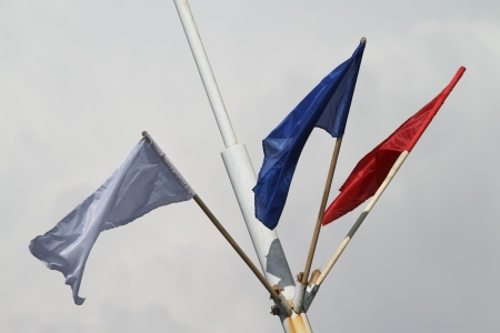 flagstaff: Blue, red, and white flags on flagstaff