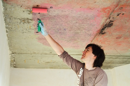 conducts: Plasterer conducts preparatory work on concrete ceiling  Stock Photo