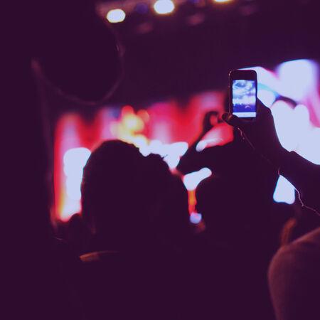People on concert looking to stage  Defocused  photo