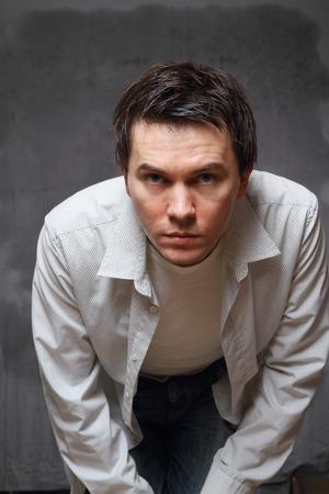 Attentive man looks into camera  Stock Photo