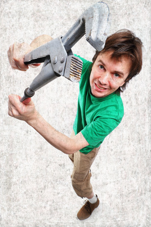 Wide-angle shot of man with adjustable spanner. photo