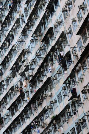 tenement buildings: Big tenement-house wall in the Hong Kong.