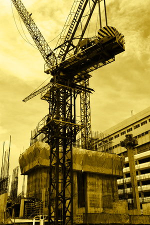 tower crane: Tower crane on the construction site. Yellow tint.