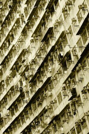 tenement buildings: Big tenement-house wall in the Hong Kong. Sepia tint.