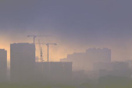 myst: Big city covered by myst. Stock Photo