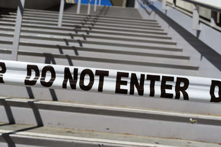 do not enter: Entrance steps closed by tape DO NOT ENTER