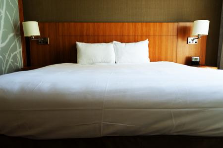 kingsize: Empty king-size bed in hotel.