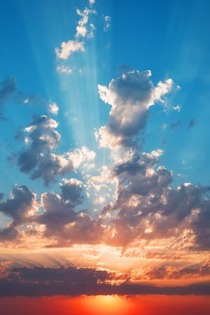 sunrays: Beautiful summer sunset with sunrays and clouds. Stock Photo