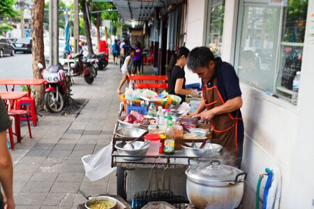 noisy: BANGKOK, THAILAND - SEPTEMBER 9, 2015: Noisy and colorful life-filled streets of Bangkok.