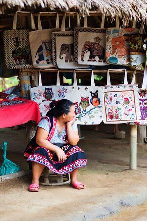 gnaw: CHIANG RAI, THAILAND - AUGUST 31, 2015: Hmong woman in the Karen Hilltribe. The Karen Village near Chiang Rai, Thailand.