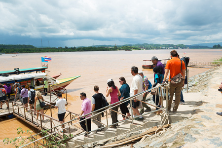 is well known: DONSAO ISLAND, LAOS - AUGUST 31, 2015: Tourists visit well known tourism site Donsao Island in Tonpheung district, Bokeo province, Laos. Editorial
