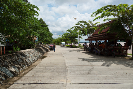 tourists stop: DONSAO ISLAND, LAOS - AUGUST 31, 2015: Tourists visit well known tourism site Donsao Island in Tonpheung district, Bokeo province, Laos. Editorial