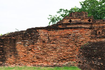 ancient brick wall: Ancient brick wall in Chiang Mai, Thailand.