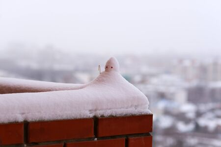 frosty: Little snowman on the high balcony. Stock Photo