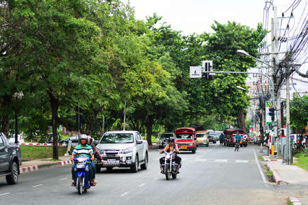 september 2: CHIANG MAI, THAILAND - SEPTEMBER 2, 2015: Noisy and colorful life-filled streets of Chiang Mai. Editorial