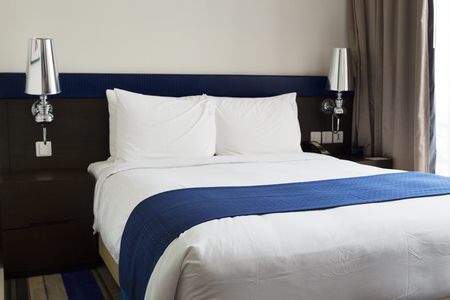 guest room: King size bed in guest room. Stock Photo