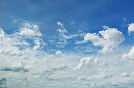 skyscapes: Fluffy clouds in blue sky.