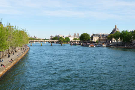 tourist attractions: PARIS, FRANCE - MAY 5, 2016: The famous Seine River. One of the tourist attractions of Paris.
