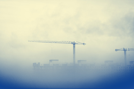 tenement buildings: Construction site covered by mist. Stock Photo