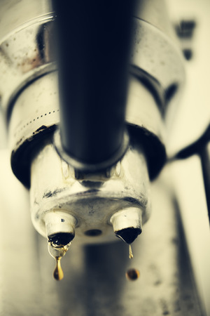 with coffee maker: Close-up of working coffee maker.