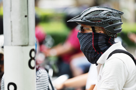 BANGKOK, THAILAND - AUGUST 16, 2016: Transport on noisy and colorful life-filled streets of Bangkok.