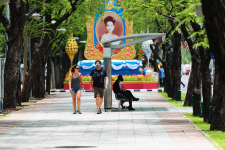 BANGKOK, THAILAND - AUGUST 17, 2016: Locals and tourists on noisy and colorful life-filled streets of Bangkok.