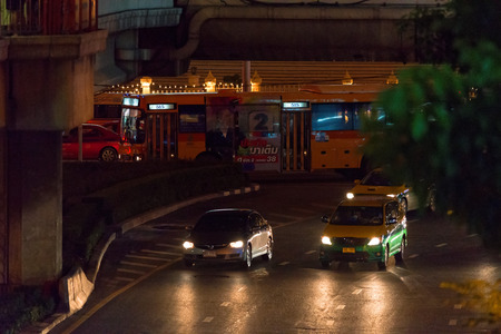 24: BANGKOK, THAILAND - AUGUST 24, 2016: Road traffic on the street in downtown of Bangkok. Night time. Editorial
