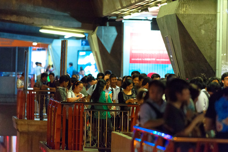 24: BANGKOK, THAILAND - AUGUST 24, 2016: Tourists and locals on the noisy and crowded night street in downtown of Bangkok. Editorial