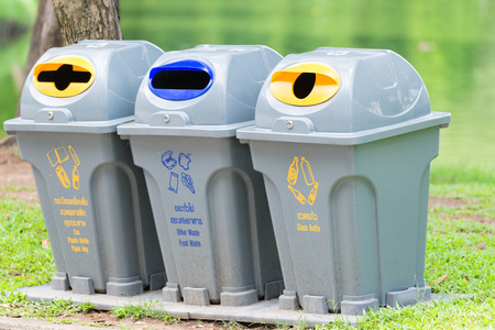 Trash cans for separated trash in the park.