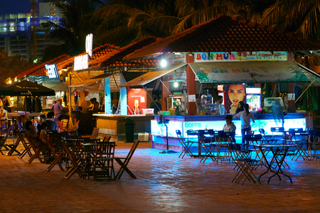 DA NANG, VIETNAM - JULY 28, 2017: Night life on the streets of Da Nang city. Tourists and locals are walking and resting in the relaxed atmosphere of this city. Editorial