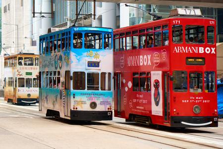 HONG KONG - SEPTEMBER 2, 2017: Famous double decker trams on the street of Hong Kong Island.