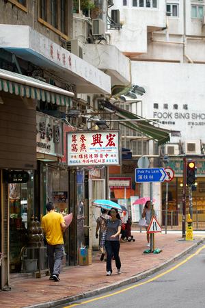 HONG KONG - SEPTEMBER 2, 2017: People walk on the streets of Hong Kong Island when its raining.