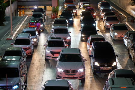 BANGKOK, THAILAND - July 21, 2017: Road traffic in Bangkok downtown. Noisy and colorful vehicles on the crowded streets at evening.
