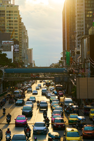 BANGKOK, THAILAND - July 5, 2017: Road traffic in Bangkok downtown. Noisy and colorful vehicles on the crowded streets.