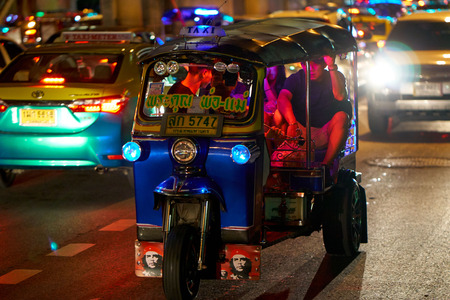 BANGKOK, THAILAND - July 21, 2017: Road traffic in Bangkok downtown. Noisy and colorful vehicles on the crowded streets at evening. 写真素材 - 103203100