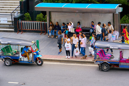 BANGKOK, THAILAND - July 13, 2017: Road traffic in Bangkok downtown. Noisy and colorful vehicles on the crowded streets. 報道画像