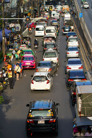 BANGKOK, THAILAND - July 22, 2017: Road traffic in Bangkok downtown. Noisy and colorful vehicles on the crowded streets. 写真素材 - 103203110