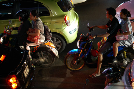 BANGKOK, THAILAND - July 21, 2017: Road traffic in Bangkok downtown. Noisy and colorful vehicles on the crowded streets at evening. 写真素材 - 103203118