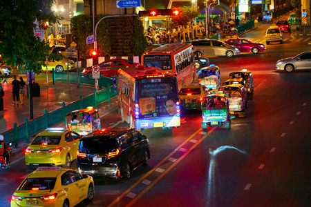 BANGKOK, THAILAND - July 9, 2017: Road traffic in Bangkok downtown at night time. Noisy and colorful vehicles on the crowded streets. 報道画像