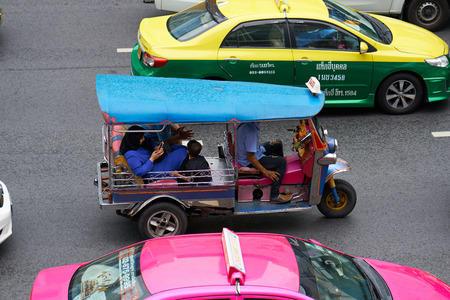 BANGKOK, THAILAND - July 19, 2017: Road traffic in Bangkok downtown. Noisy and colorful vehicles on the crowded streets. 報道画像