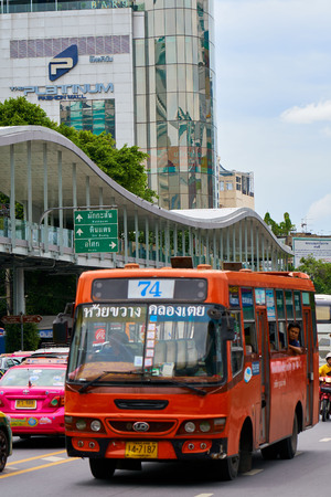 BANGKOK, THAILAND - July 20, 2017: Road traffic in Bangkok downtown. Noisy and colorful vehicles on the crowded streets.
