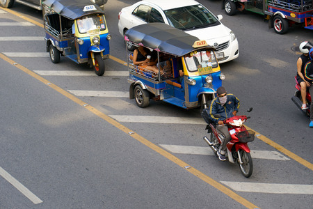 BANGKOK, THAILAND - July 22, 2017: Road traffic in Bangkok downtown. Noisy and colorful vehicles on the crowded streets.